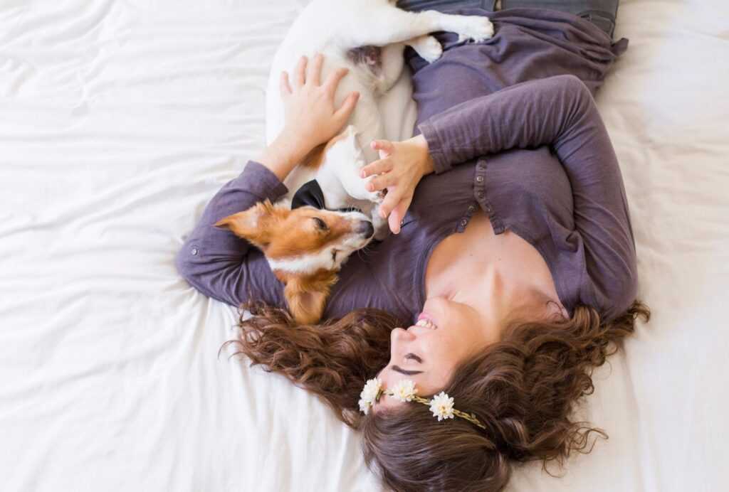 Schedule in some regular cuddle and bonding time with your clingy dog to help satisfy his need for affection